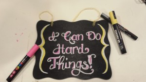 chalk board style painted sign reads I can do hard things